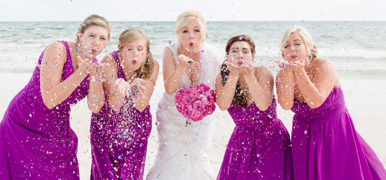Island Sands Beach Weddings Bride Blowing Confetti