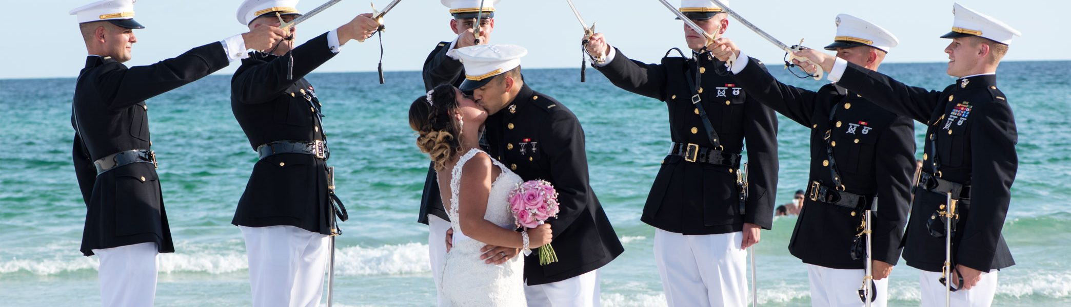 Marines holding swords over married couple during Destin Beach Wedding