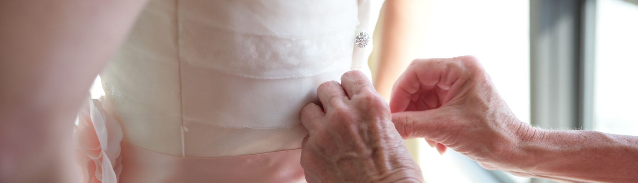 Elder Woman's hands helping Bride before Island Sands Beach Wedding