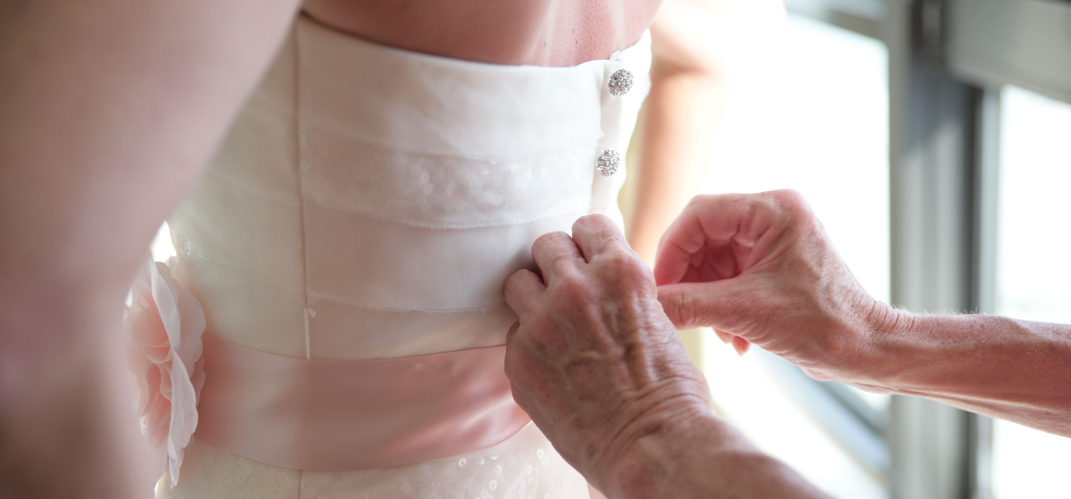 Elder Woman's hands helping Bride before Island Sands Beach Wedding